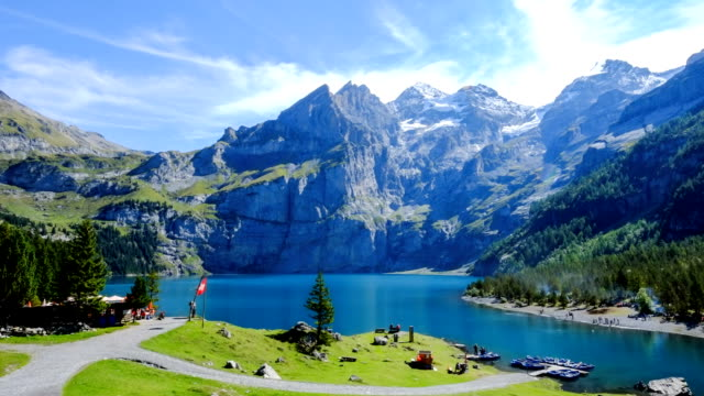 Oeschinen lake and the alps on the other side near Kandersteg on bernese oberland in Switzerland Timelapse - Stock Video