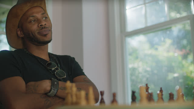 MCU of a confident man playing chess