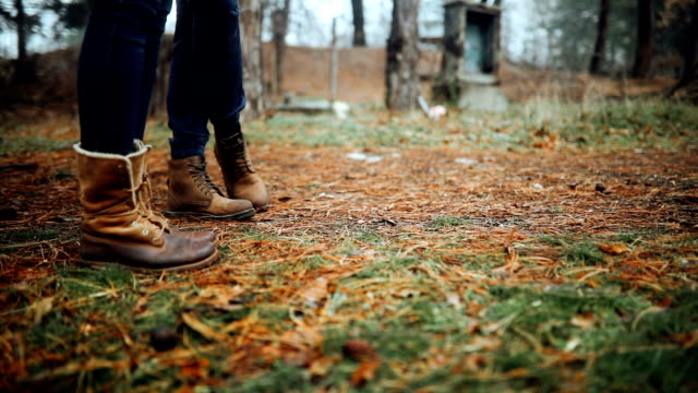360 of a couple's legs standing in the forest