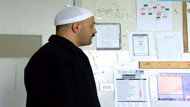 of a druze sheikh, in traditional attire, lecturing a classroom of boys. irfan is a religious school with five branches in lebanon that operate as... - teenage boys stock videos & royalty-free footage