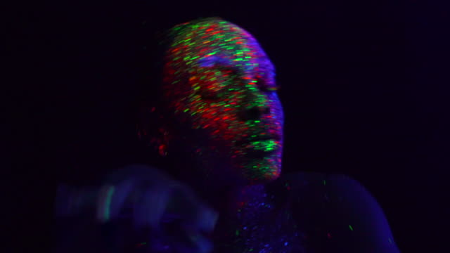 a scratch edit of a person dancing under an ultraviolet blacklight - fluorescent stock videos & royalty-free footage