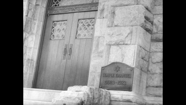 of a protestant christian church / man walks past the gates of a roman catholic church / ext of jewish temple. churches of different denominations in... - judaism video stock e b–roll