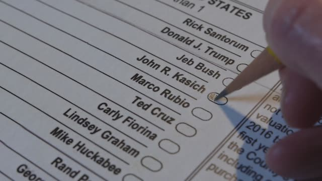 XCU of a voter marking a Republican presidential primary ballot for John Kasich