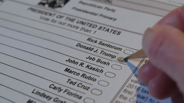 xcu of a voter marking a republican presidential primary ballot for donald trump - wahlschein stock-videos und b-roll-filmmaterial