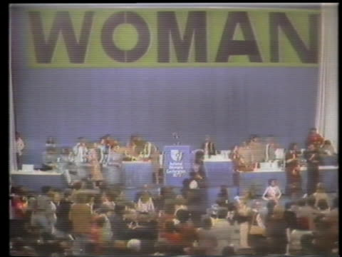 of a woman speaking at a podium a woman speaking in a crowd cheering women mcu of a woman sitting with a sign women walking around the conference... - frauenrechte stock-videos und b-roll-filmmaterial