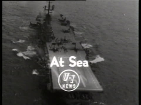 of aircraft carrier on ocean / graphics superimposed / no sound - aircraft carrier stock videos & royalty-free footage