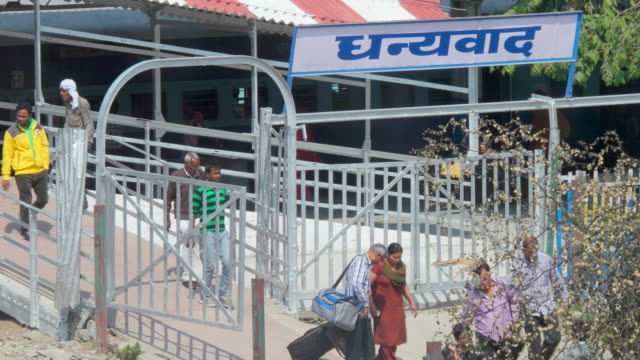 tl of an exit gate at a train station with a huge signboard in hindi saying 'thank you' - carrying stock videos & royalty-free footage