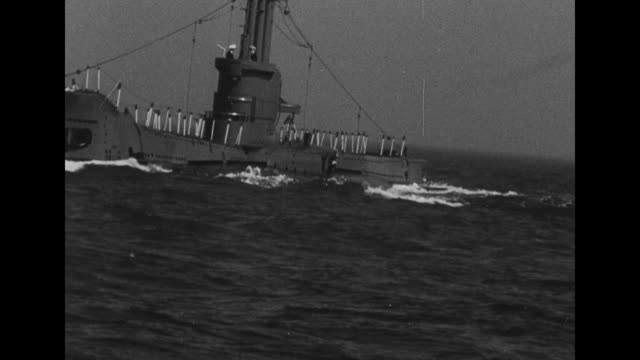 vídeos de stock, filmes e b-roll de sot of an unidentified officer briefly noting rescue efforts were denied success / vs pov several vessels on the water a ship with vertical white... - compasso