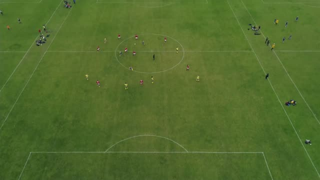 of asian grassroots football players subjected to racist abuse; england: ext air views of multiple football training pitches - pitch stock videos & royalty-free footage