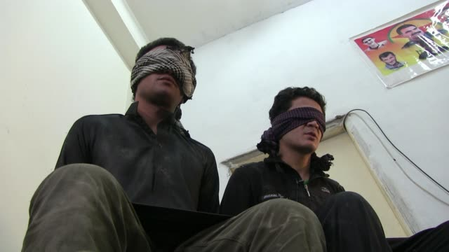 of blindfolded detainees suspected to be isis or isil militants captured by fighters of the kurdish people's protection units ypg on october 13, 2014... - people's protection units stock videos & royalty-free footage