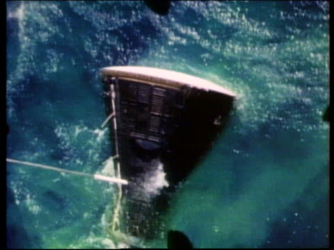 aerial of cable attached to space capsule in ocean - splashdown stock videos and b-roll footage
