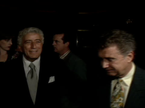ots of cameraman zi to cu tony bennett with arms around regis philbin talking in crowd at rainbow room - tony bennett singer stock videos and b-roll footage