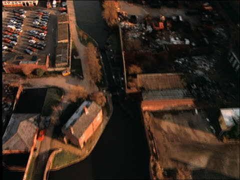 AERIAL of canal + industrial cityscape / Manchester / England