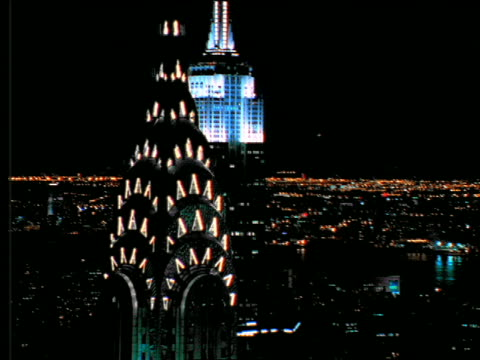 vídeos de stock, filmes e b-roll de aerial of chrysler + empire state buildings at night / nyc - 2001