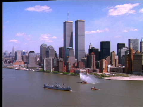 aerial of downtown manhattan skyline / boats in foreground - world trade center manhattan video stock e b–roll