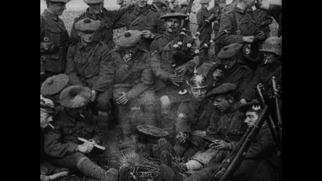 vídeos y material grabado en eventos de stock de / has of dreadnaught tank moving on road marching soldiers following cheering and waving at camera hams of group of toronto scottish regiment... - cavalry