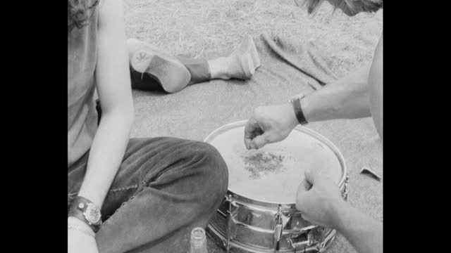 of drugs, cannabis being prepared, by festival goers at 1971 glastonbury festival, on worthy farm, pilton - drummer stock videos & royalty-free footage