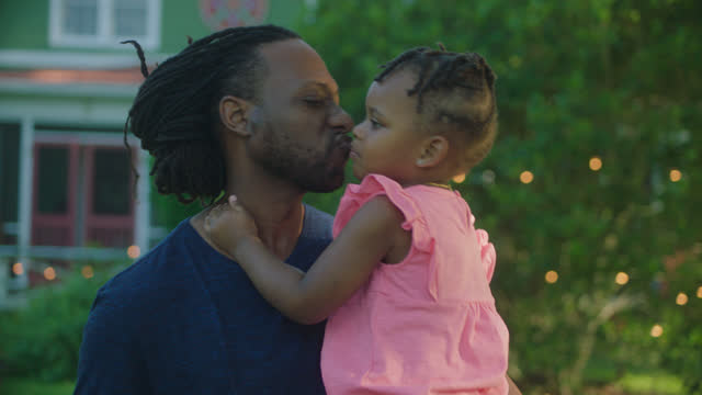 MCU of father kissing his daughter