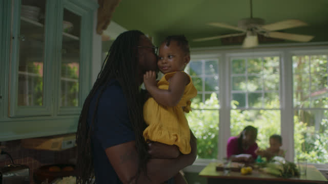 mcu of father loving and holding child - genderblend stock videos & royalty-free footage
