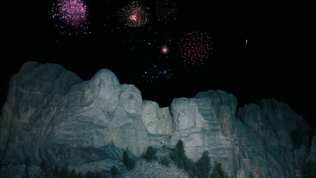 TILT UP of Fireworks over Mount Rushmore / Keystone, South Dakota