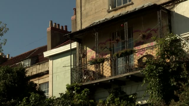 vídeos de stock e filmes b-roll de of flat with window boxes and hanging baskets of plants in the montpelier area of bristol england - montpelier