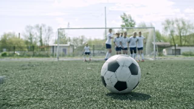 slowmo of free kick on soccer field - ゴールを狙う点の映像素材/bロール
