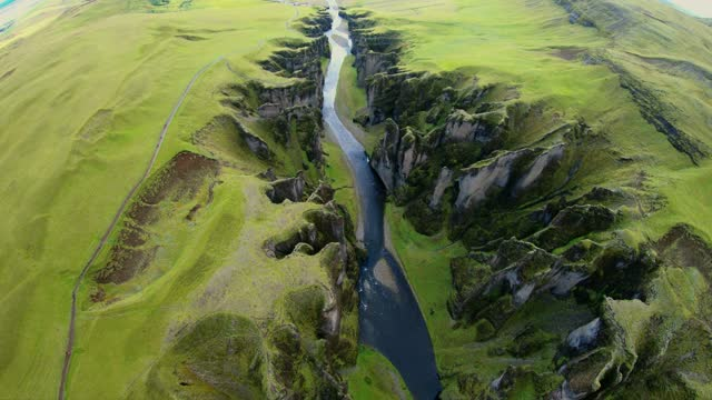 bird's eye view of icelandic extravagant river formation - canyon stock videos & royalty-free footage