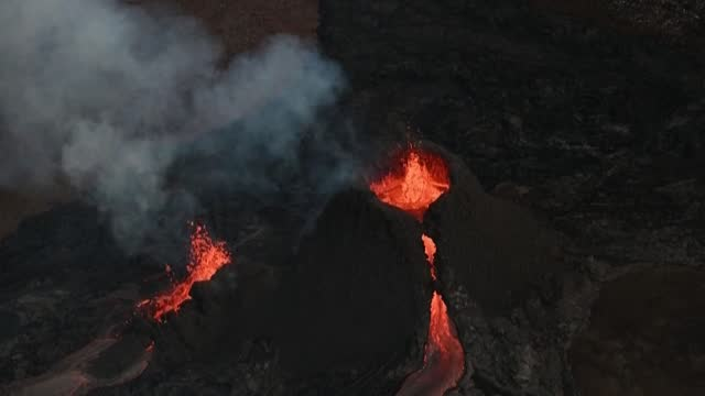 of iceland's erupting volcano and curious onlookers flock to marvel at the hypnotic display of glowing red lava - psychedelic stock videos & royalty-free footage