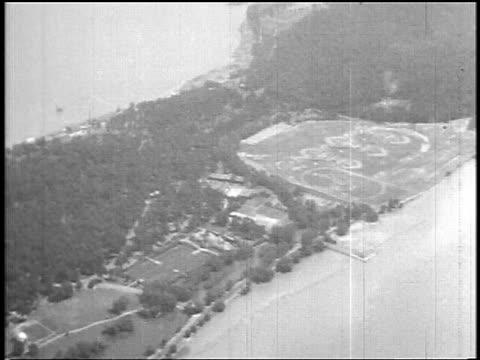 stockvideo's en b-roll-footage met b/w 1927 aerial of land + ocean below / newsreel - 1927