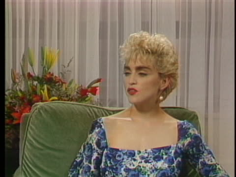 """of madonna sitting during an interview """"to me, the definition of being an opportunist is someone who seizes the moment and gets the most out of what... - singer stock videos & royalty-free footage"""