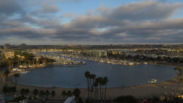 TIME LAPSE of Marina Del Rey boat harbor and mother beach at sunset with a full moon in Los Angeles