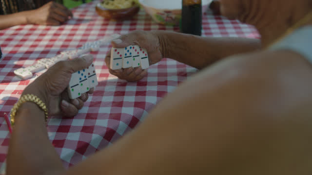 OTS of mature man playing dominos