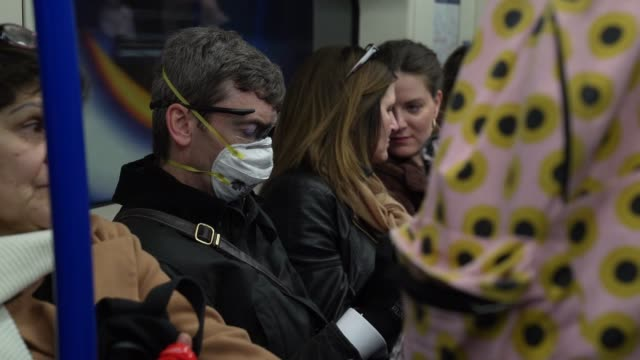 of member of the public wearing face mask and eye protection glasses on the london underground at coronavirus outbreak in london on march 06, 2020 in... - protective face mask stock videos & royalty-free footage
