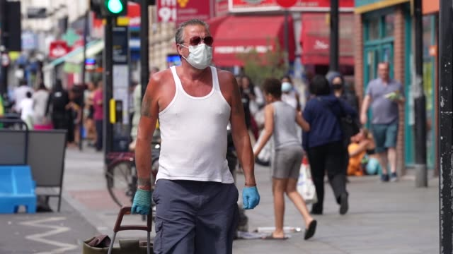 slomo of members of the public wearing ppe face mask in dalston east london during the coronavirus covid19 pandemic the british government further... - adult stock videos & royalty-free footage