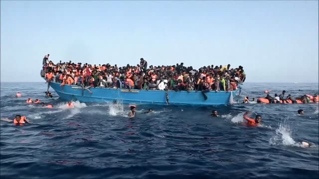 images of migrants being rescued by ngo proactiva open arms on the mediterranean sea north of libya - refugee stock videos & royalty-free footage