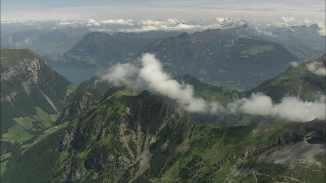 ws aerial view of mountains around lake lucerne / lucerne, switzerland - uneven stock videos & royalty-free footage