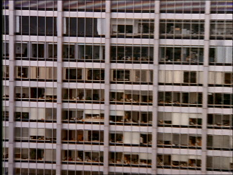 aerial of office building viewed thru windows - fensterfront stock-videos und b-roll-filmmaterial