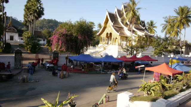 TL of Pedestrians and Traffic in Front of Temple in Luang Prabang, Laos.