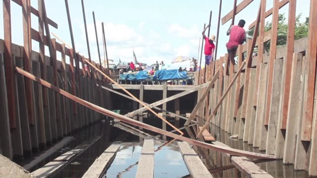 of people building barges in dr congo a country where lakes and rivers are widely used in preference to a poor highway system - barge stock videos & royalty-free footage