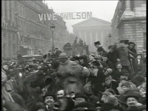 paris mass of people celebrating outside sign across street 'vive wilson' ha ws mass of people in street ms people ha ms hanging 've wilson' sign - armistice day stock videos and b-roll footage