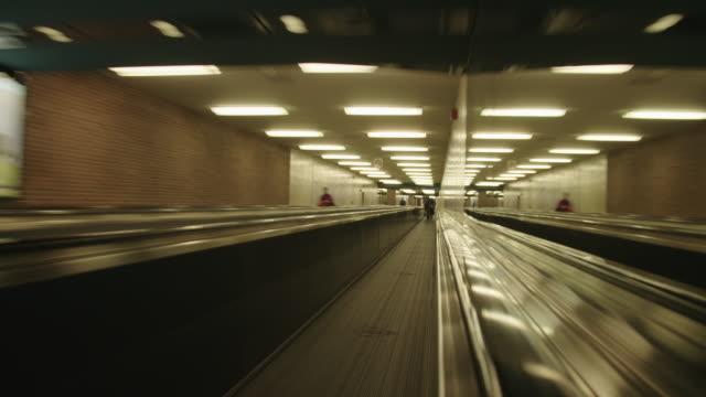 pov tl of people on travelator in airport - flugpassagier stock-videos und b-roll-filmmaterial