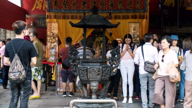 tl of people praying at a public shrine in taiwan - taipei stock videos & royalty-free footage