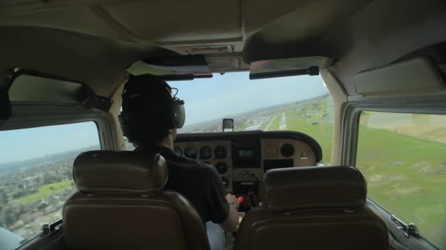 MS REAR VIEW of pilot turning plane toward runway for landing / Novato, California, USA