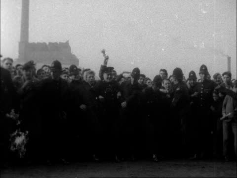 stockvideo's en b-roll-footage met ls of pitch with crowds of crowds on it ms of crowds waving frantically ms trophy being shown to crowds ms crowd ms crowd ms crowd - 1956