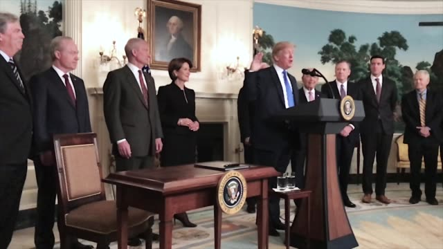 A GIF of President Trump signing a Presidential Memorandum On Sanctioning China Over Economic Aggression