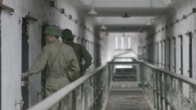 ws re-enactment of prison guard guarding at hoa lo prison / eastern state penitentiary historic site, philadelphia, pennsylvania, united states - eastern state penitentiary stock videos & royalty-free footage