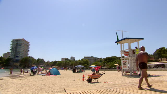 of quiet beach in majorca, during the height of tourism season, due to coronavirus pandemic - majorca stock videos & royalty-free footage