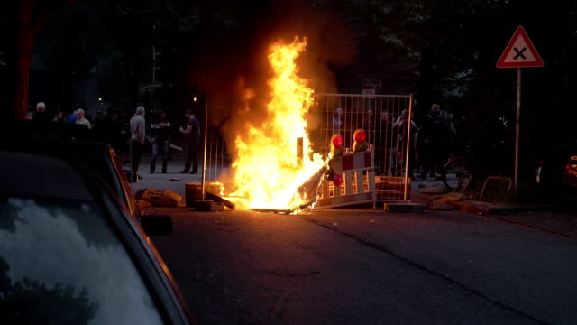 13% of real time slow motion shot of a fire caused by demonstrators during g20 summit in hamburg germany - group of 20 stock videos & royalty-free footage