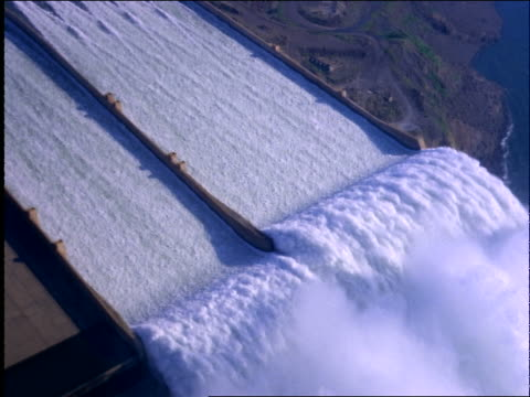 aerial of rushing water in hydroelectric dam / brazil - wildwasser fluss stock-videos und b-roll-filmmaterial