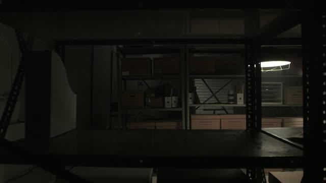 dolly shot of shelves in storage room - 証拠点の映像素材/bロール